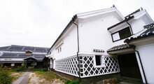"Shikkui on exterior and interior walls of traditional architect in Uchiko-machi Japan. 3 dimensional geometric design black and white shikkui ""Noro"""